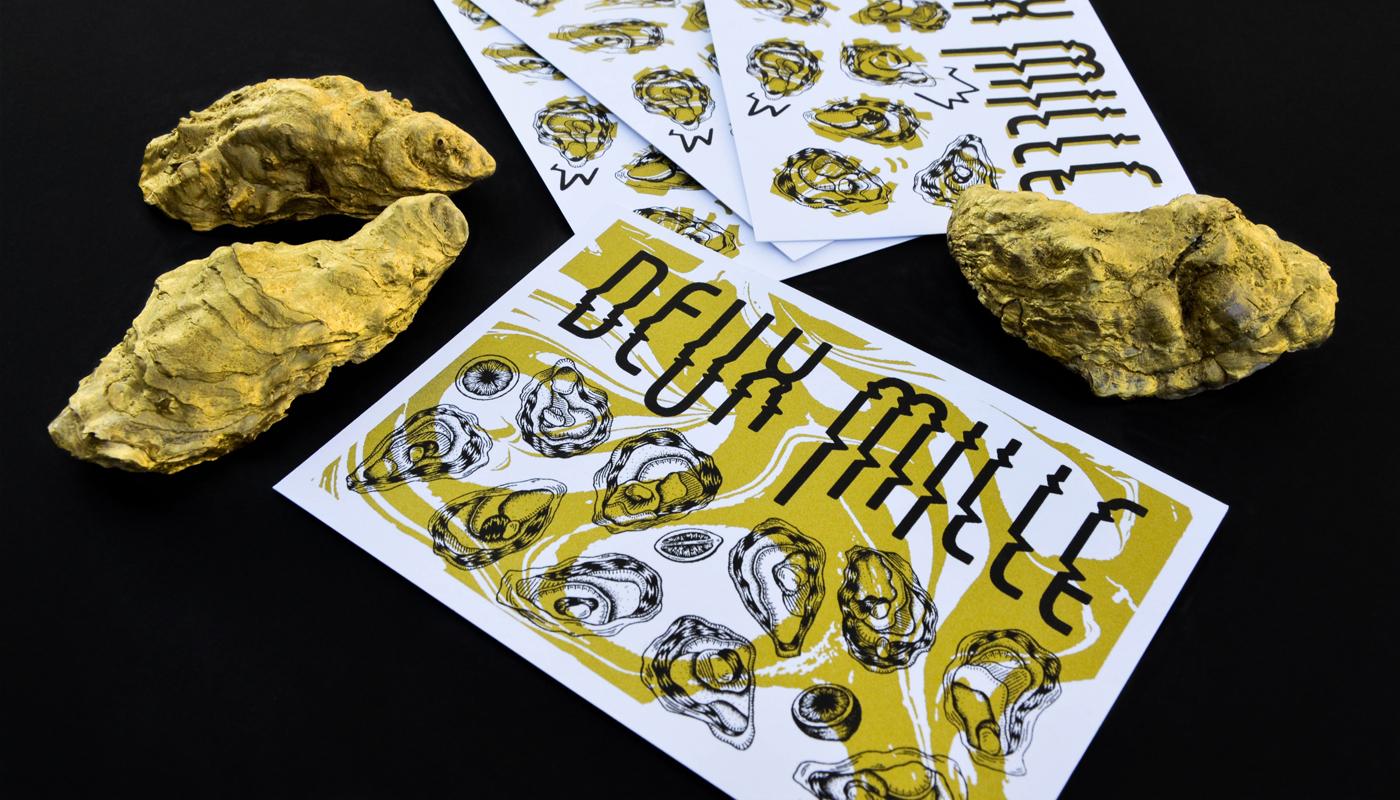 Photo détail des rectos des cartes de voeux 2018 imprimées en sérigraphie par Superfruit. Couteau à huitres, citron et marbrures dorées